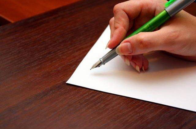 Basescu a promulgat modificarea Legii notarilor publici