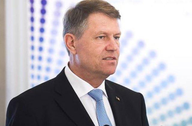 Klaus Iohannis a promulgat legea privind votul anticipat si prin corespondenta pentru romanii din strainatate
