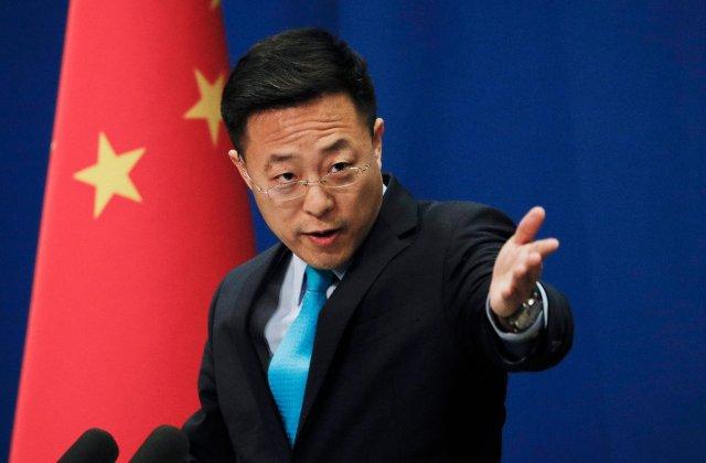Oficial chinez: virusul din Wuhan ar fi putut fi adus de armata SUA