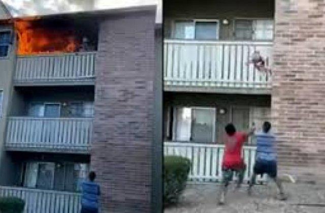 VIDEO Copil aruncat de la etajul unui bloc care se afla în flăcări. Cum a fost salvat băiatul de 3 ani
