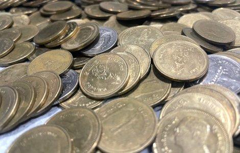 Record Guinness pentru cea mai mică monedă comemorativă din lume
